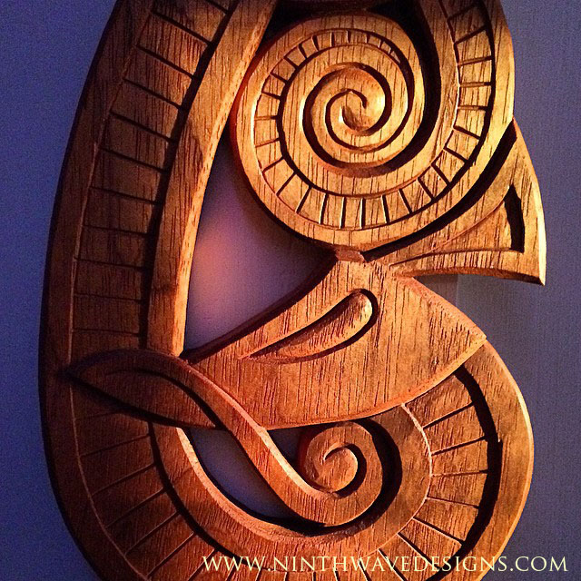 Detail of Viking inspired dragon carving in mahogany.